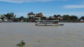 A passenger boat goes up Chao Phraya River stock video