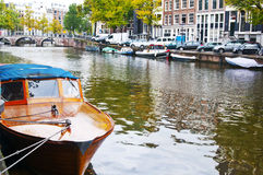 Passenger boat on the Herengracht canal in Amsterdam Stock Photos