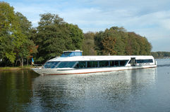Passenger boat on lake Stock Photos