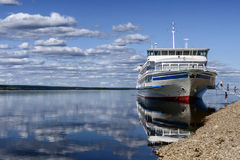 Passenger boat moored to a river Lena bank Royalty Free Stock Photos