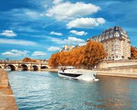 Passenger boat passes Pont Neuf on Seine in Autumn. Passenger boat passes Pont Neuf on Seine river in Autumn Royalty Free Stock Photo