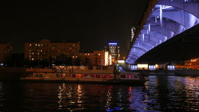 Passenger boat passes under the bridge on the Moscow River. stock footage