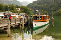 Passenger boat and pier. Konigssee. Germany stock photo
