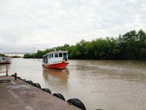 Passenger boat in river arrive to the port Stock Photo
