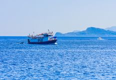 Passenger boat on the shore of the island of Rhodes, Greece Royalty Free Stock Photos