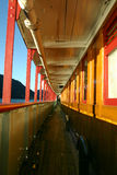 Passenger boat walkway. View down a narrow walkway on a brightly colored wooden boat Stock Photos