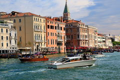 Passenger boats and gondola in Grand Canal in Venice, Italy Stock Image