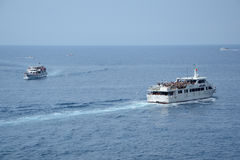 Passenger boats nearby Riomaggiore city Royalty Free Stock Photo