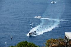Passenger boats nearby Riomaggiore city Royalty Free Stock Photos
