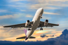 Passenger business airplane take off and flying in blue sky suns Royalty Free Stock Photos