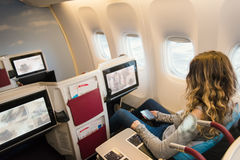 Passenger in business class of airplane Stock Images