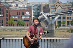 Passenger Busking Stock Photo