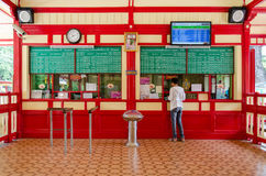 Passenger buying rail ticket from the ticket window. Royalty Free Stock Images