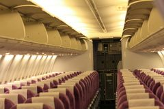 Passenger cabin. Aircraft passenger cabin, all sit and baggage hold was particularly disigned Royalty Free Stock Image