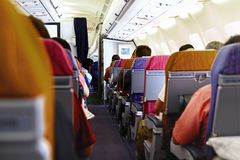 The passenger cabin of the aircraft. The rows of seats Royalty Free Stock Images