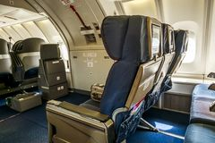 The passenger cabin of the Boeing 747-400 stock images