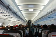 Passenger cabin in flight with people. Economy class. View from above Stock Image