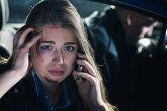 Passenger calling for a help after a car crash Stock Photos