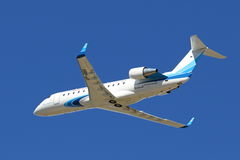 The passenger Canadair Bombardier CRJ-200 plane in the sky of Ya Stock Photo