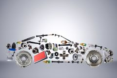 Passenger car assembled from new spare auto parts for shop aftermarket. Isolated on grey background Stock Photos