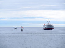Passenger and Car Ferry In the Ocean Bay. Car and Passenger Ferry boat on the Water leaving from victoria to washington with mountains in the background on a Royalty Free Stock Photos