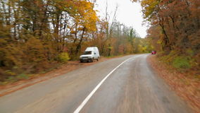 Passenger Car Moving In Autumn Forest Along stock video