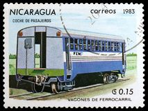 Passenger car, Railroadcars serie, circa 1983. MOSCOW, RUSSIA - MARCH 23, 2019: Postage stamp printed in Nicaragua shows Passenger car, Railroadcars serie, circa stock photos