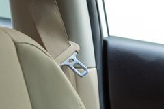 Passenger car safety belt and leather cream. stock images