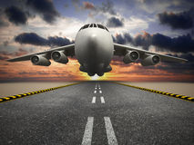 Passenger or cargo airplane taking off at sunset. White passenger or cargo airplane taking off at sunset Stock Image