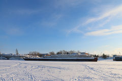Passenger and cargo ships in frozen river Royalty Free Stock Image