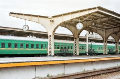 Passenger cars at the old station with a clock. Konpet trains by train, waiting, meeting and seeing off for a trip. royalty free stock photos