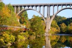Passenger cars under bridge stock images
