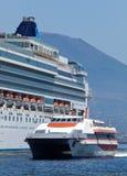 Passenger catamaran and a large cruise ship Royalty Free Stock Photos