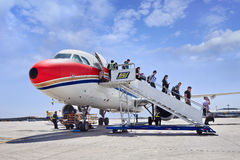 Passenger come out airplane on Beijing Capital International Airport. Royalty Free Stock Photo