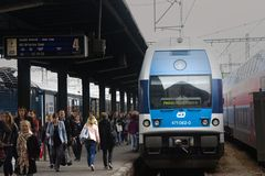 Passenger commuter train at railway station in capital of Europe. Prague, Czech Republic - October 19, 2017: passenger commuter train at railway station in Royalty Free Stock Image