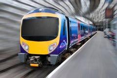 Passenger Commuter Transport Train Motion Blur. Modern Passenger Commuter Transport Train with Motion Radial Zoom Blur Stock Image