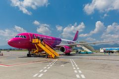 Passenger compartment of aircraft company Wizzair royalty free stock photography