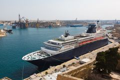 Passenger cruise liner in the Malta Grand Harbor. In sunny weather Royalty Free Stock Images