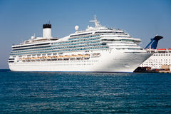 Passenger cruise ship. Large white passenger ship waiting in Rhodes Island port Stock Photos