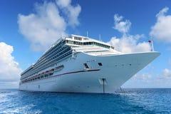Passenger Cruise Ship Achored at Sea. Luxury passenger cruise ship anchored at sea royalty free stock image