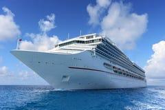 Passenger Cruise Ship at Sea. Luxury passenger cruise ship at sea during sunny day royalty free stock photography