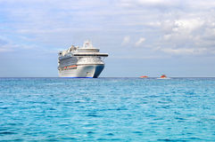 Passenger Cruise Ship and Tender Boats Stock Image