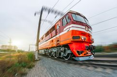 Passenger diesel train traveling speed railway wagons journey light. Royalty Free Stock Image