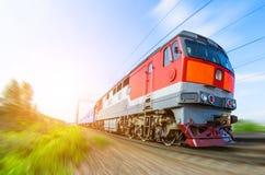 Passenger diesel train traveling speed railway wagons journey light Stock Image