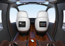 Passenger Drone interior. Monitor mounted on seats backrest. Headsets on each seats and smartphone on small table stock illustration