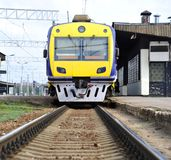 Passenger electric train. At platform at station Stock Photography