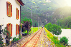 Passenger eletric tramway moves to Meiringen. Switzerland Stock Image