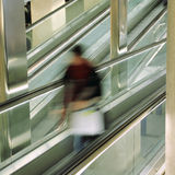 Passenger on escalator at at the airport Royalty Free Stock Photos