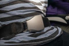 Passenger fastening seat belt for safety. On the airplane stock photos