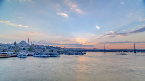 Passenger Ferries in the Golden Horn at sunset timelapse, Istanbul skyline, Turkey stock video